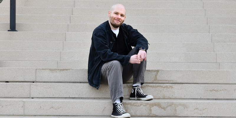 Ryan Gillispie sitting on stairs.